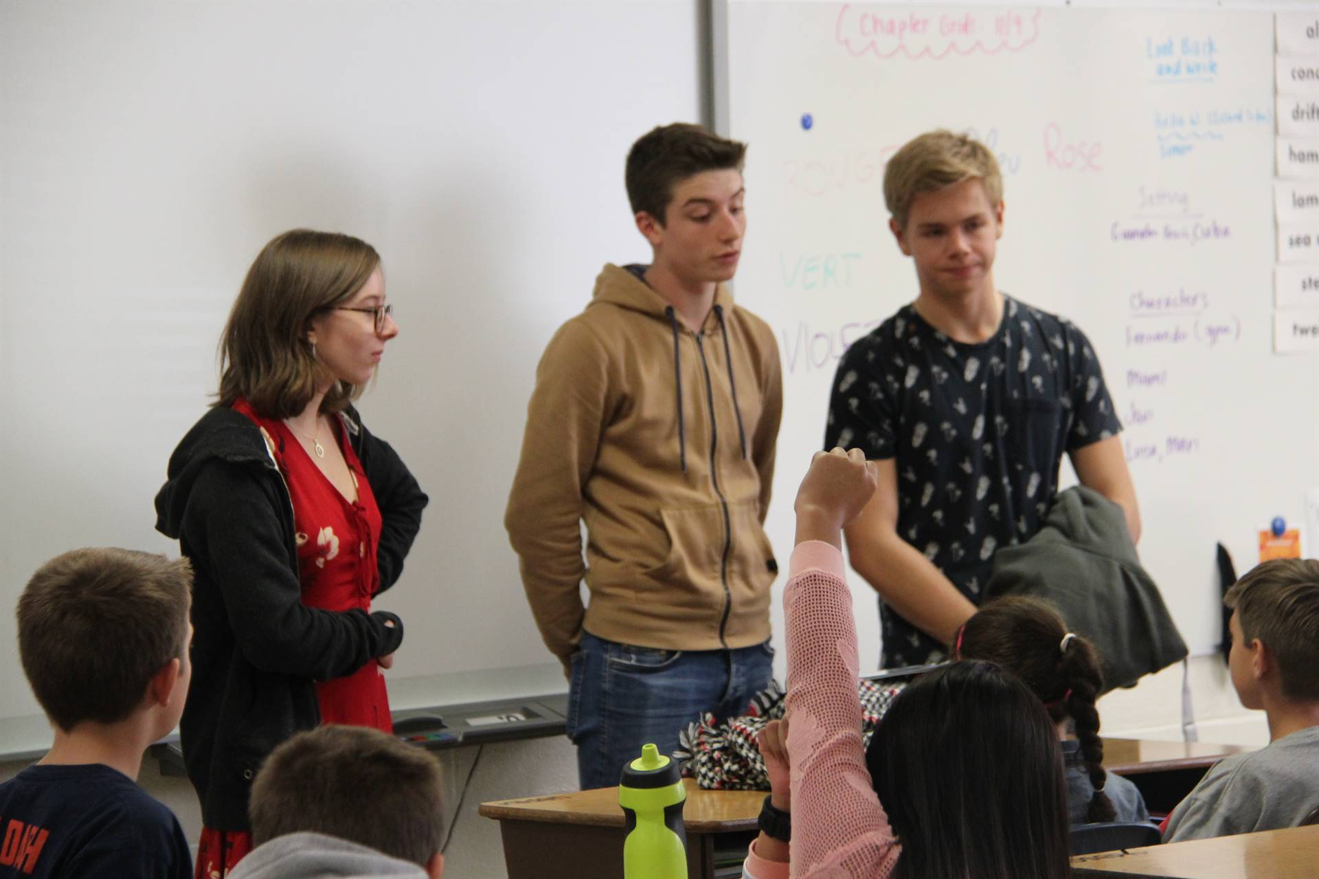 up close of three students answering questions in elementary classroom