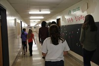 elementary students and french exchange crew in chenango bridge hall way