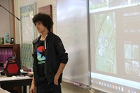 french exchange student shows elementary students where they go to school in france