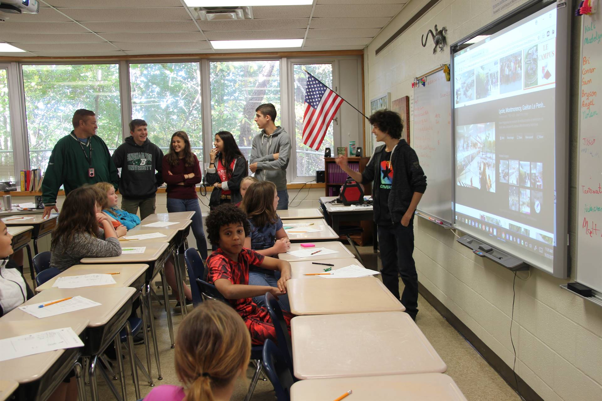 french students talk to elementary classroom