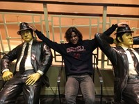 student with blues brothers statues