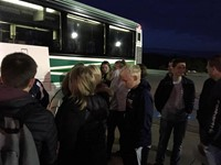 french exchange students packing bus to leave