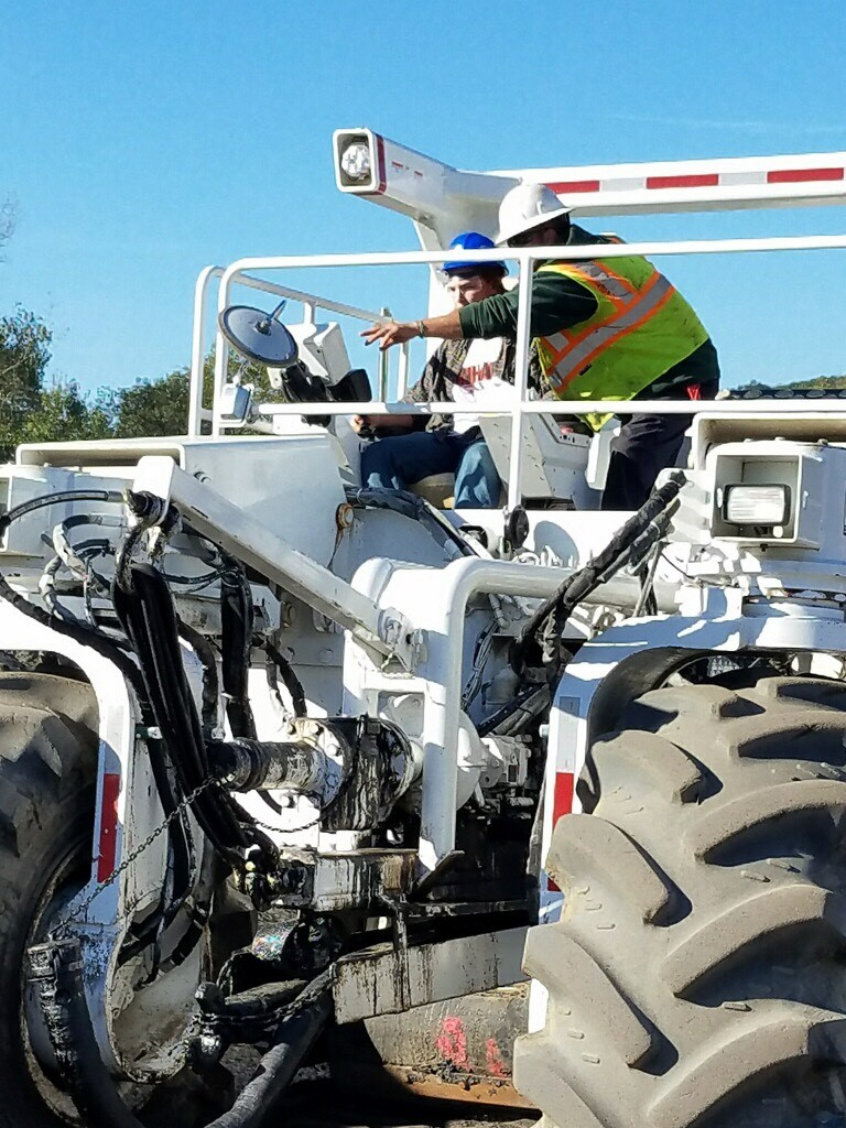 up close of student working with equipment on construction career day
