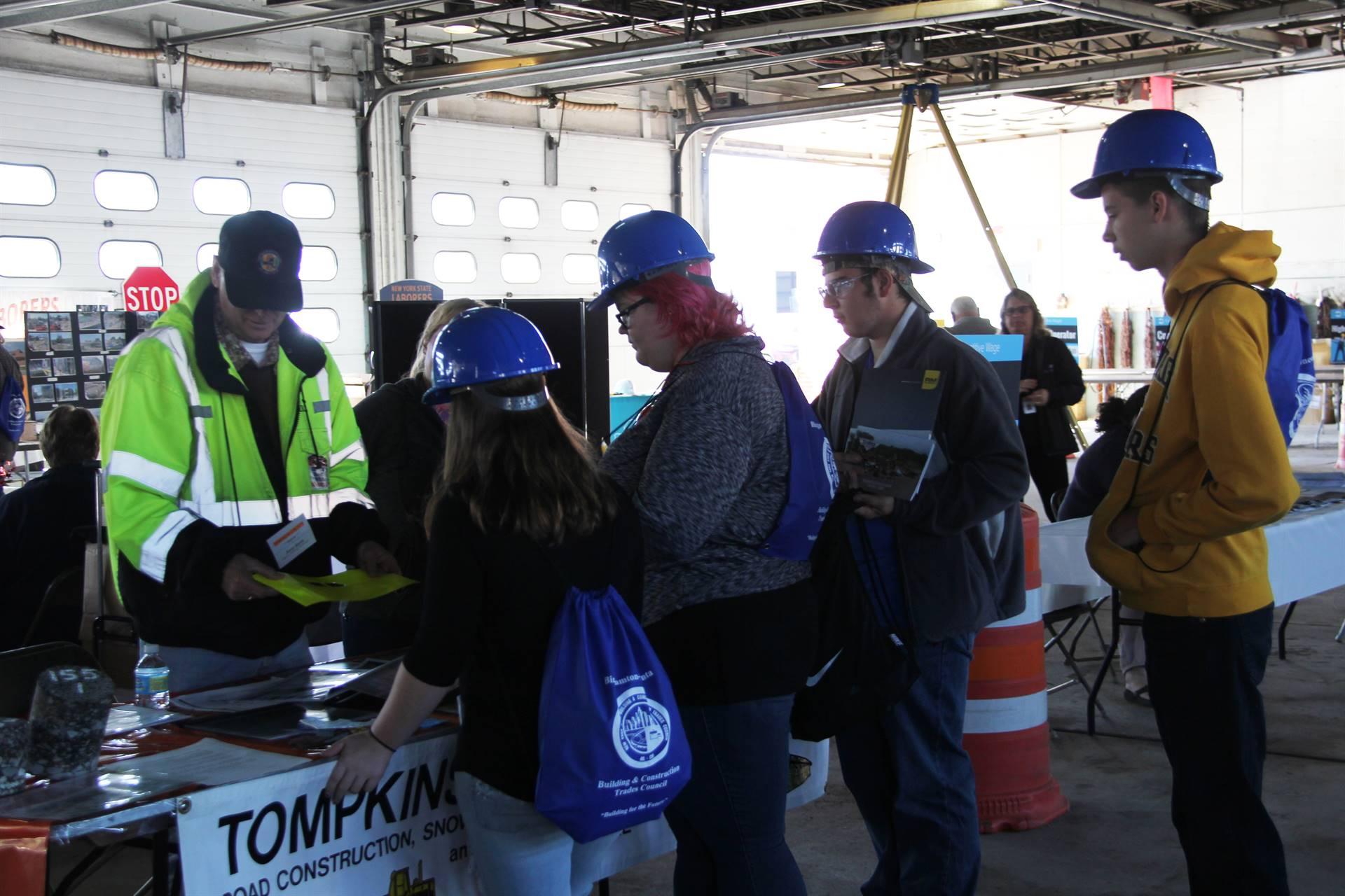 students talk to representatives at construction career day