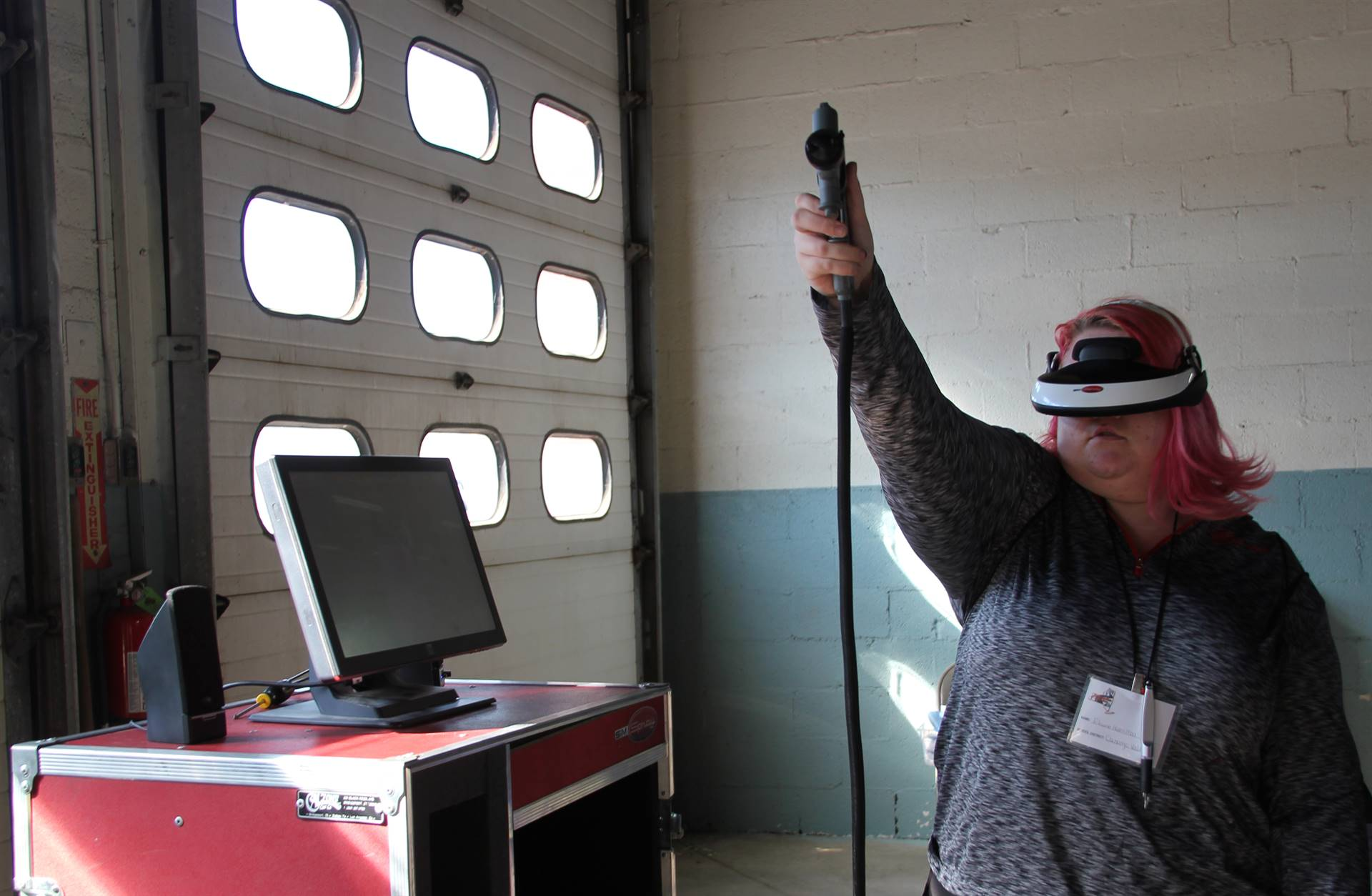 student tests out virtual reality painting equipment at construction career day