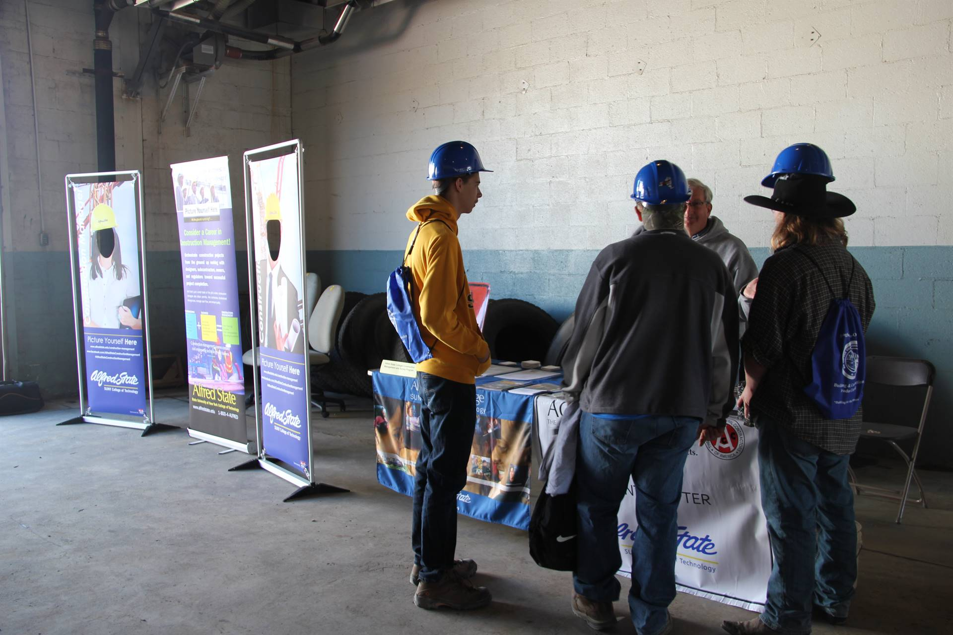 students talk to college representative at construction career day