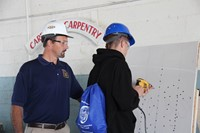 student tests out drilling at construction career day