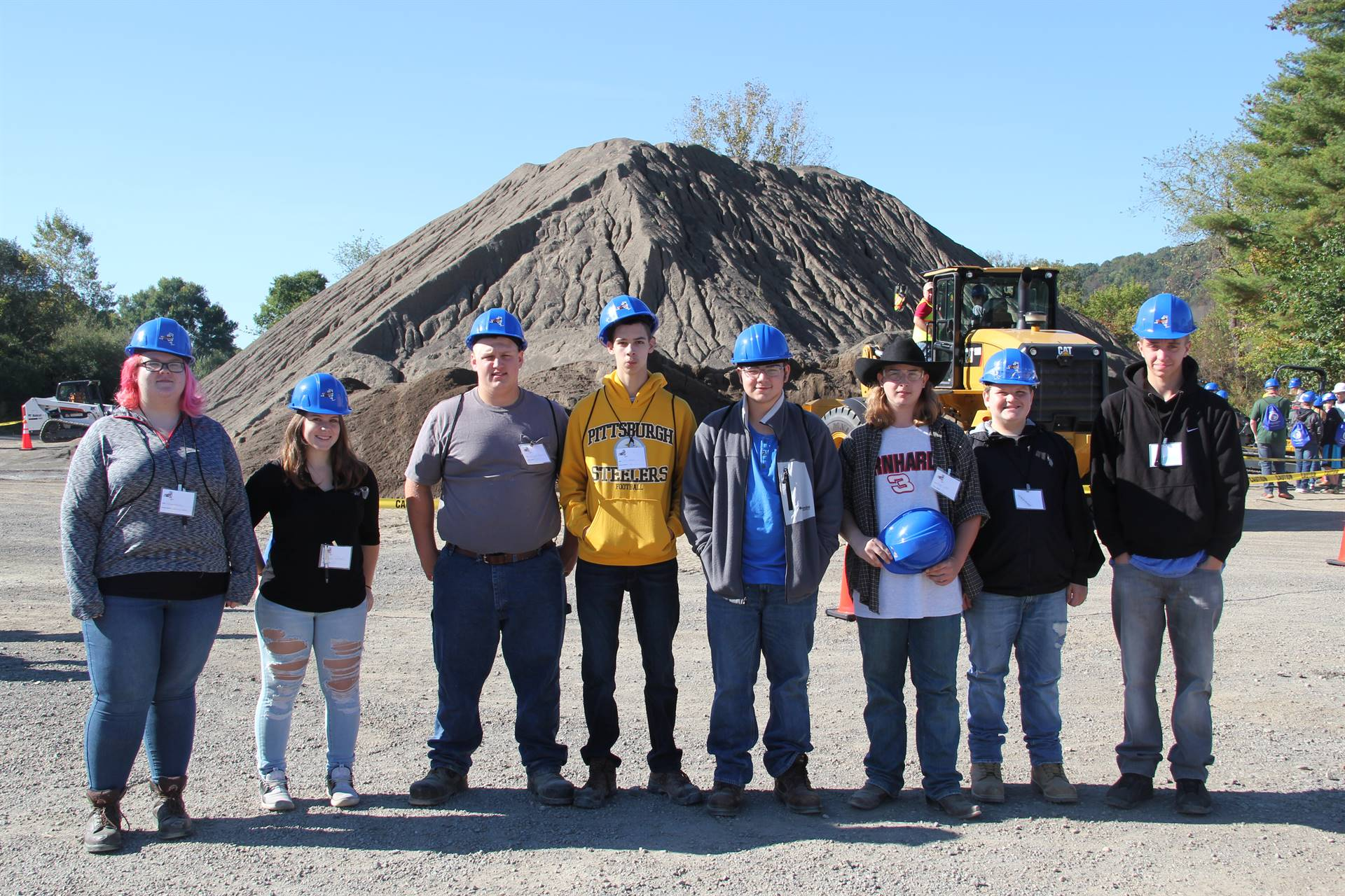 group shot of eight c v students at construction career day