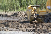 up close shot of equipment moving mud