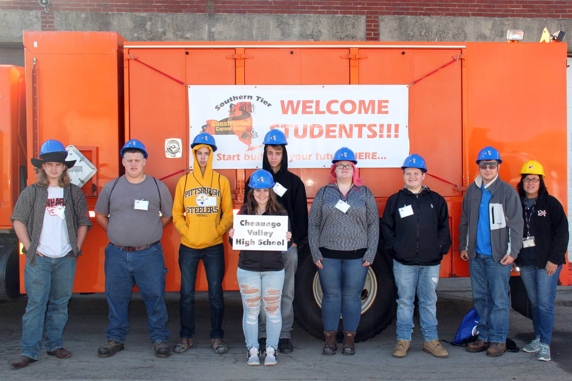 students in front of construction career day sign