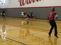 boys varsity football take place in passing challenge against a few teachers playing defense