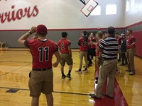boys varsity football lined up for passing challenge