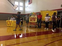 girls tennis team about to do a skit at high school pep rally