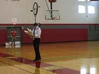 mister stafford juggling with a unicycle balancing on his face