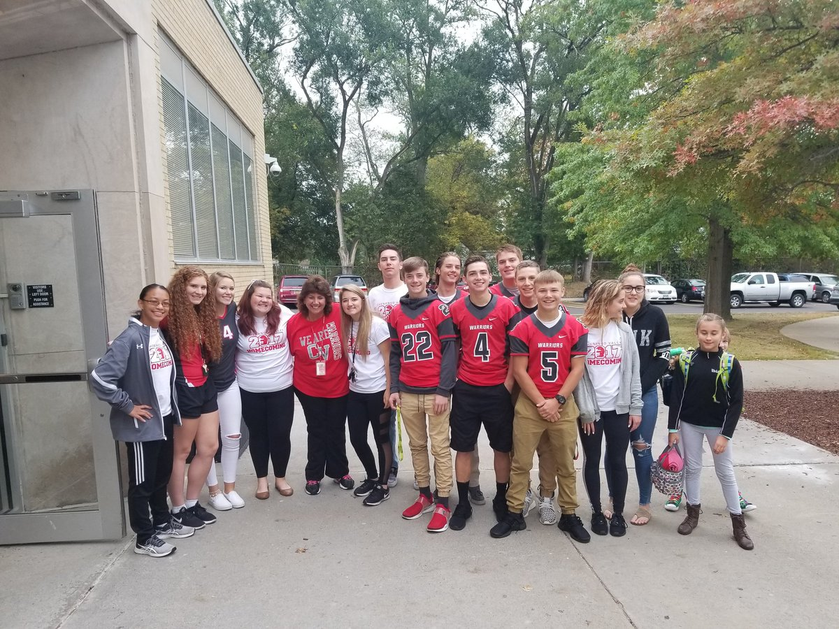 high school students doing warrior welcome stand in front of chenango bridge with principal hammond