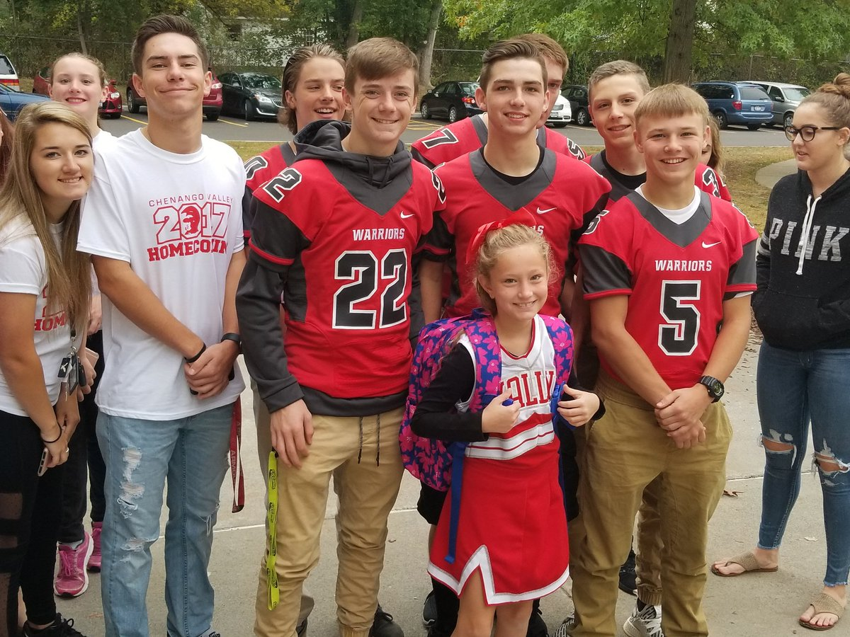 high school student athletes welcome elementary students to school during warrior welcome