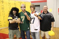 teachers dressed as football players and ref at pep rally