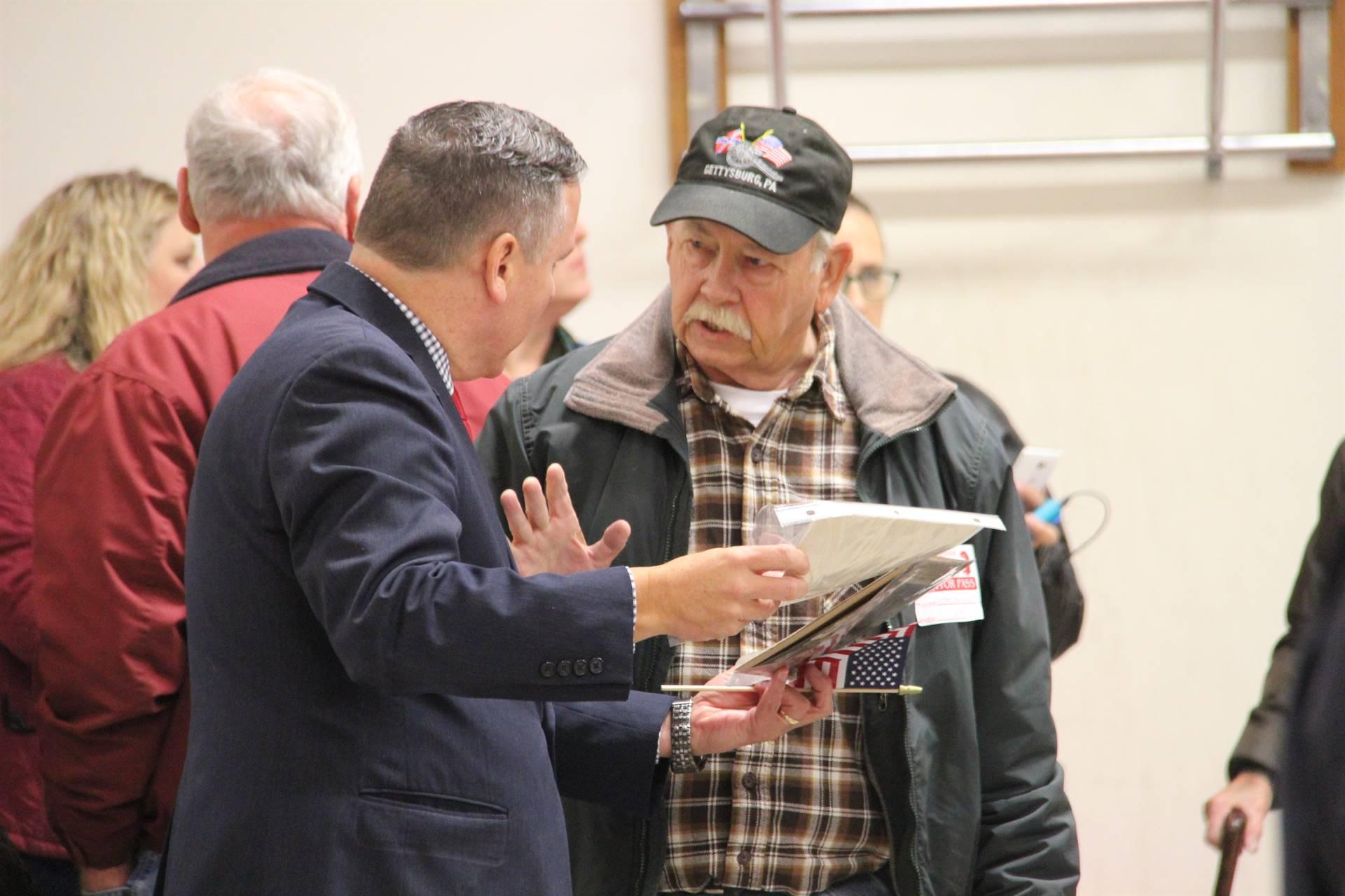 mister gill talking to veteran