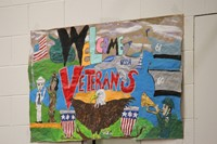 painted sign that says welcome veterans
