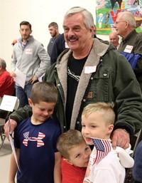 veteran smiling with family members
