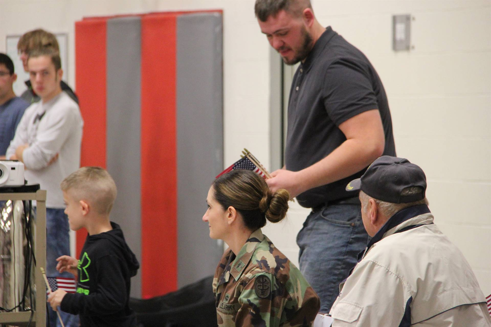boy gives veteran a thank you card at port dickinson elementary