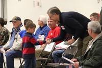 boy gives veteran handshake