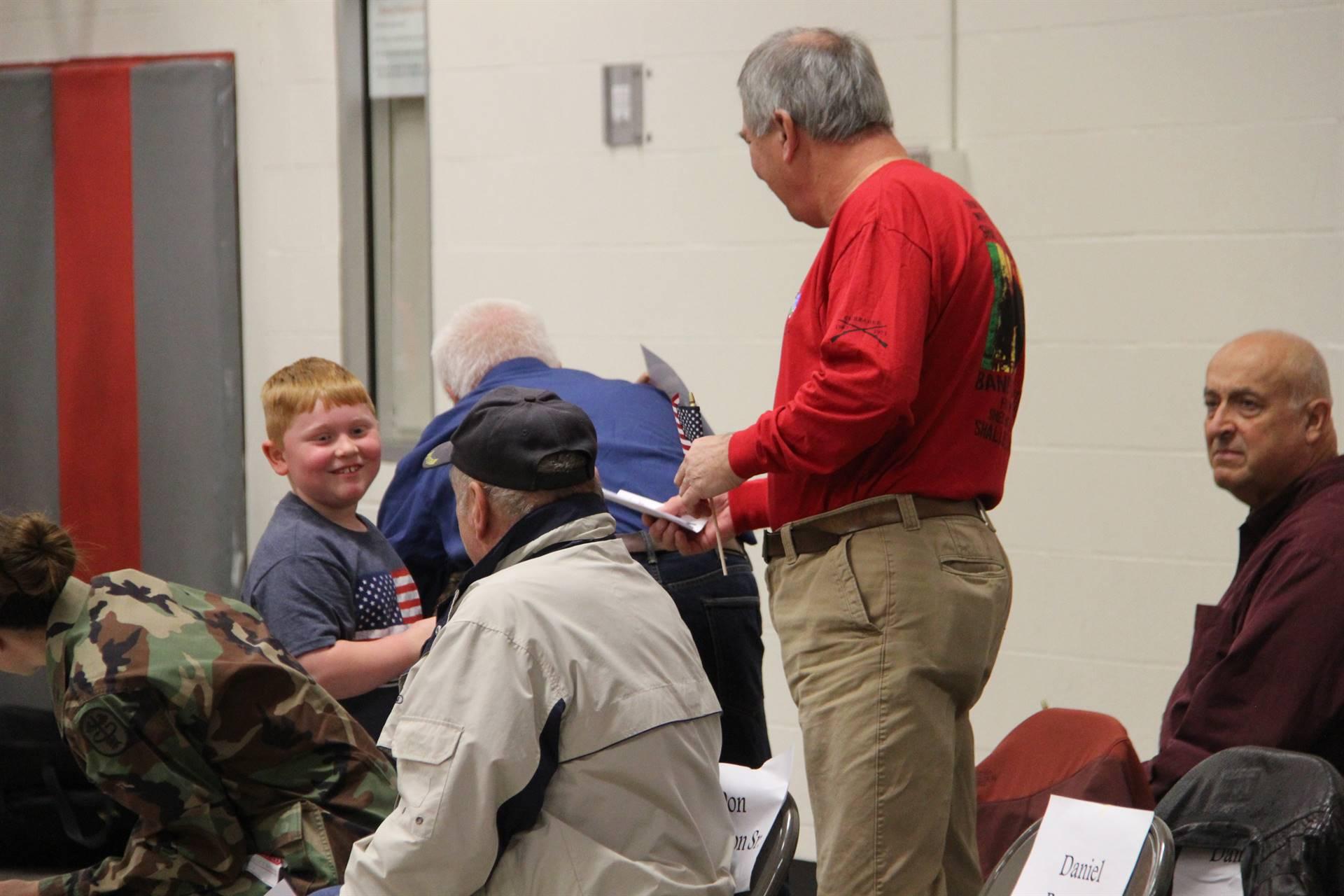 boy giving veteran thank you card