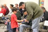 boy handing veteran thank you card