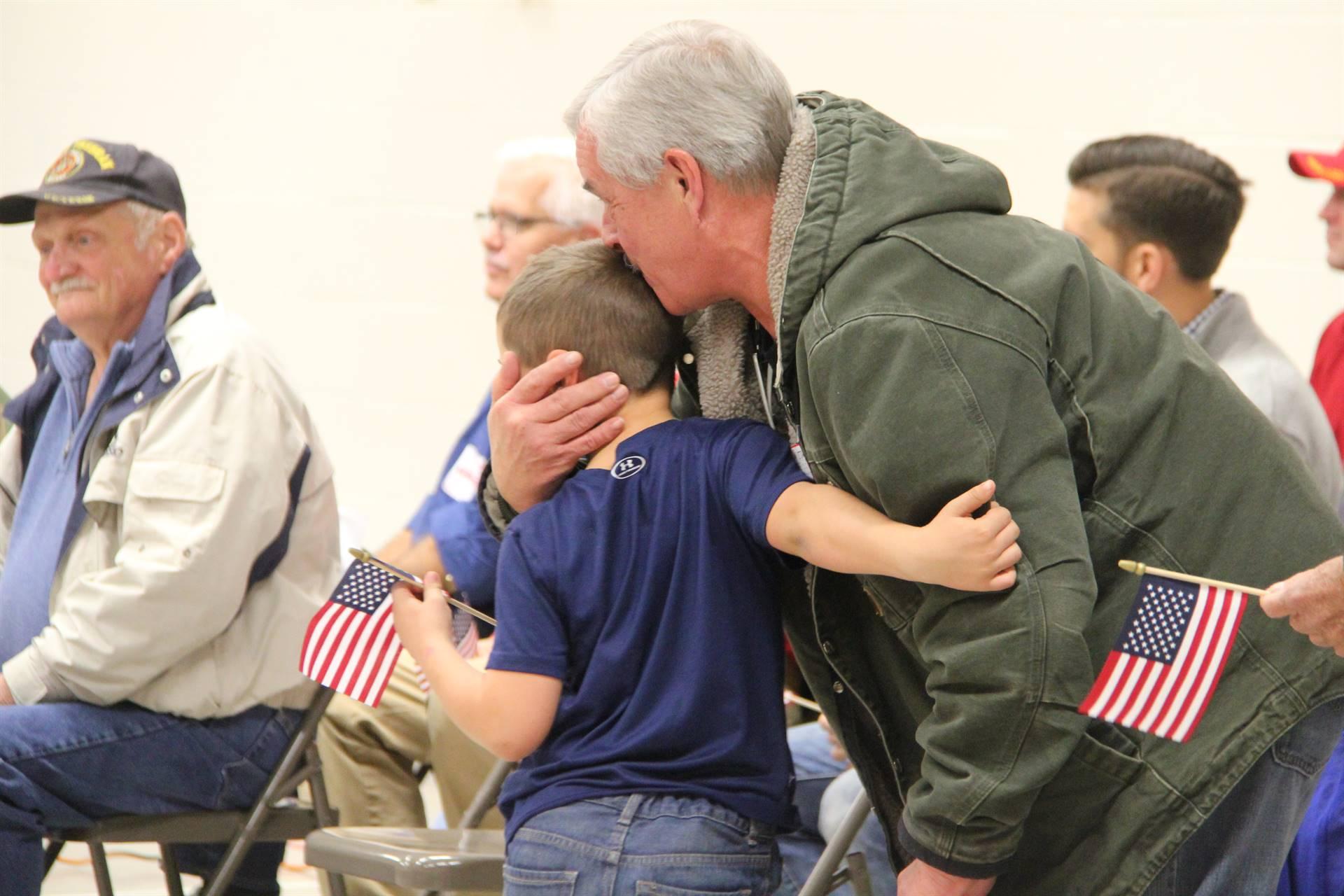 boy giving veteran a hug