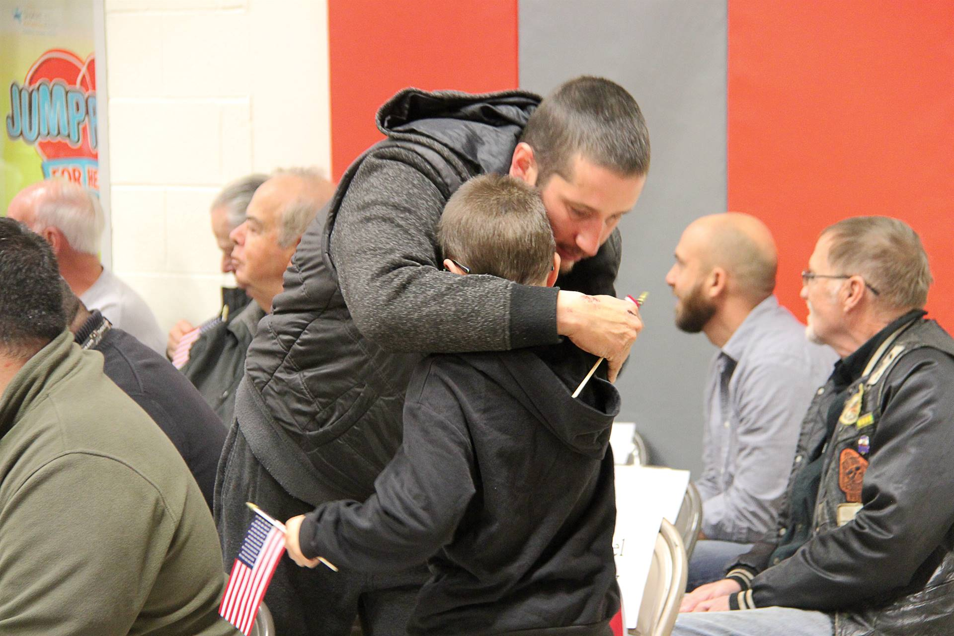 veteran gives family member hug after receiving thank you card