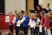 closer shot of students reading patriotic poem