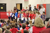 far shot of students reading patriotic poem