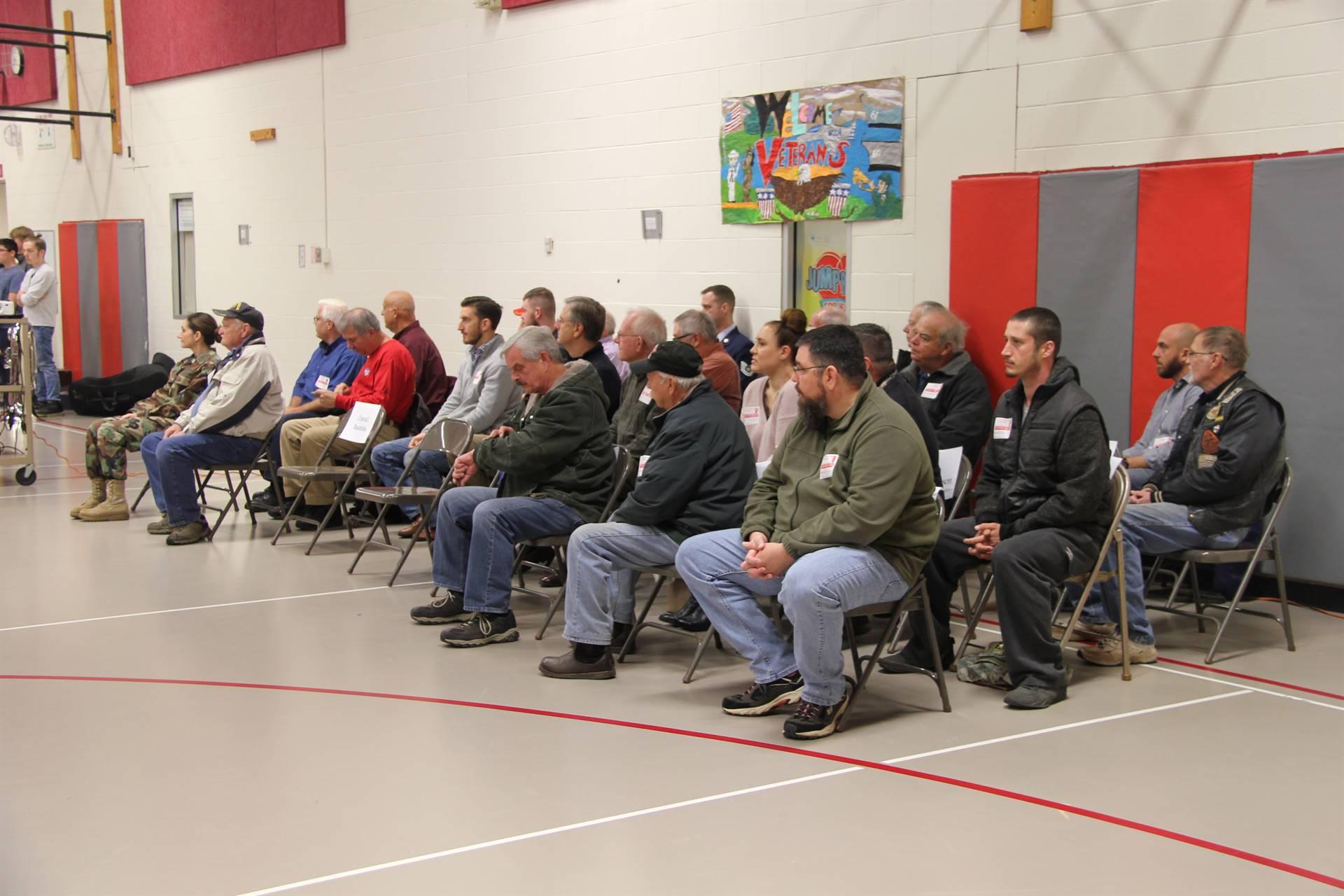 veterans listening to children read patriotic poem