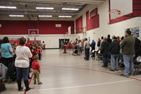 wide shot of color guard leaving assembly