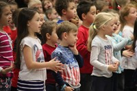 children signing and singing patriotic song