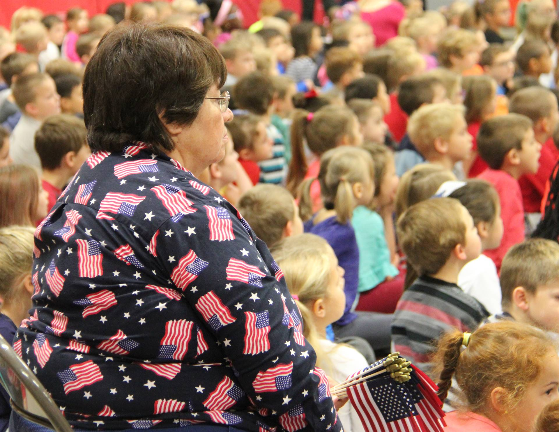 teaching holding flags wearing american flag shirt