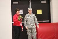 teacher and veteran standing near doorway