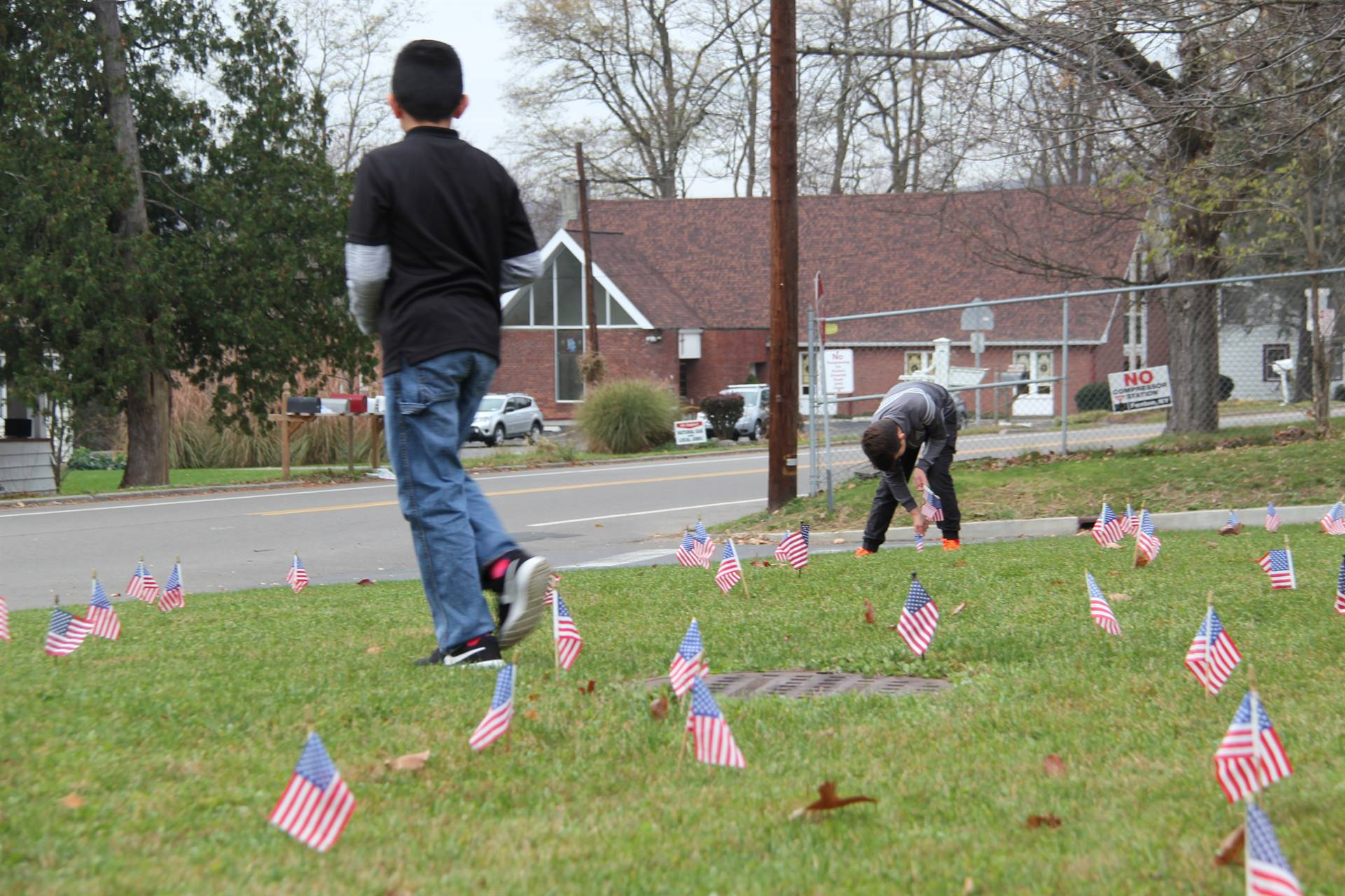 two students planting american flags