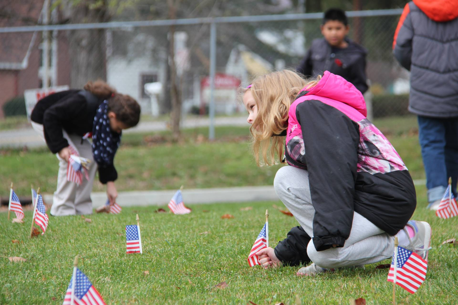students planting flags