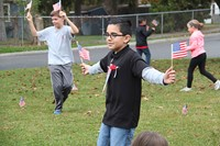 boy waves flags in both hands