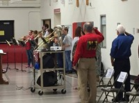 brass ensemble performing and veterans saluting