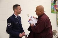 veteran and military member talking