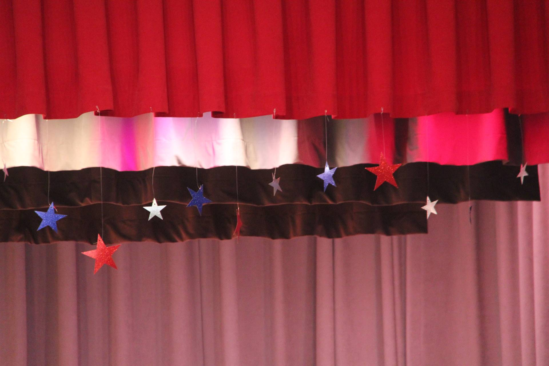 red white and blue stars hanging at top of stage