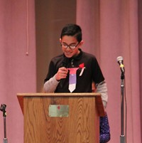 boy talking at podium at veterans day assembly