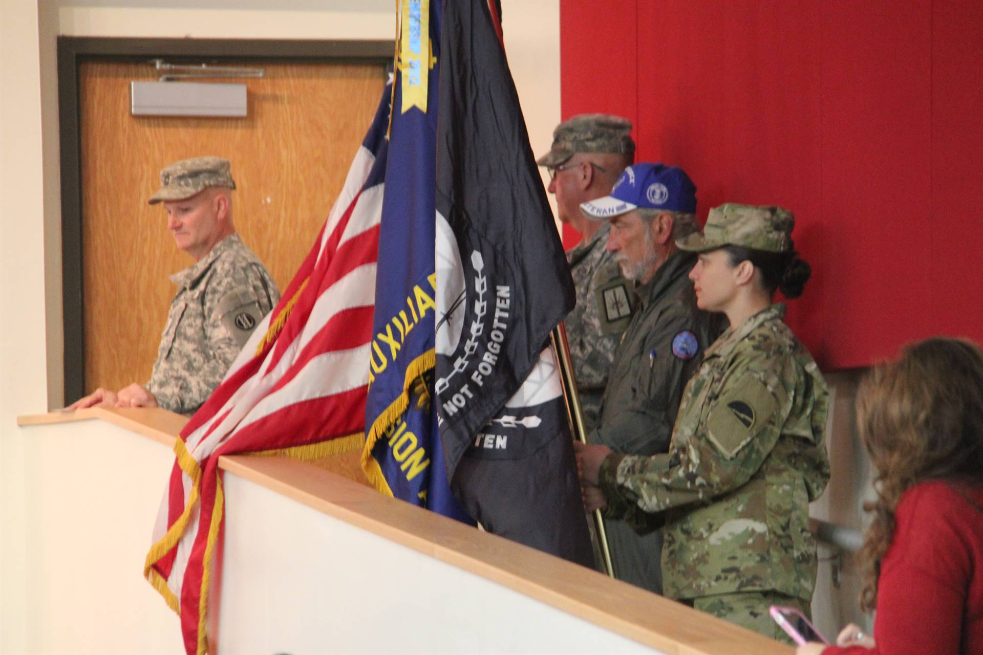 veterans from the american legion at veterans day assembly