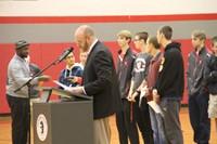 mister tomm talking at podium