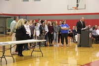 girls swim team at fall sports awards