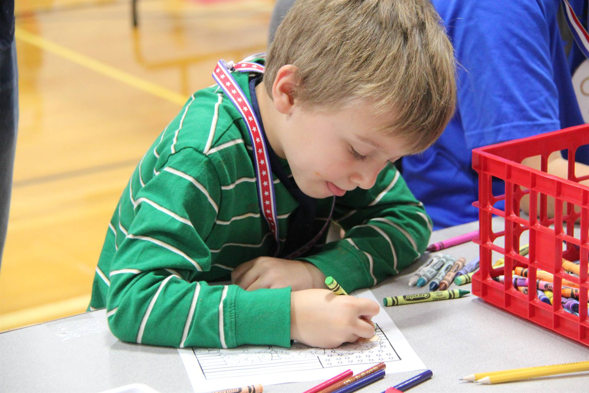boy coloring at humanities night