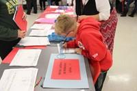 boy writing letter to veterans