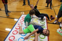 boys playing an educational twister game